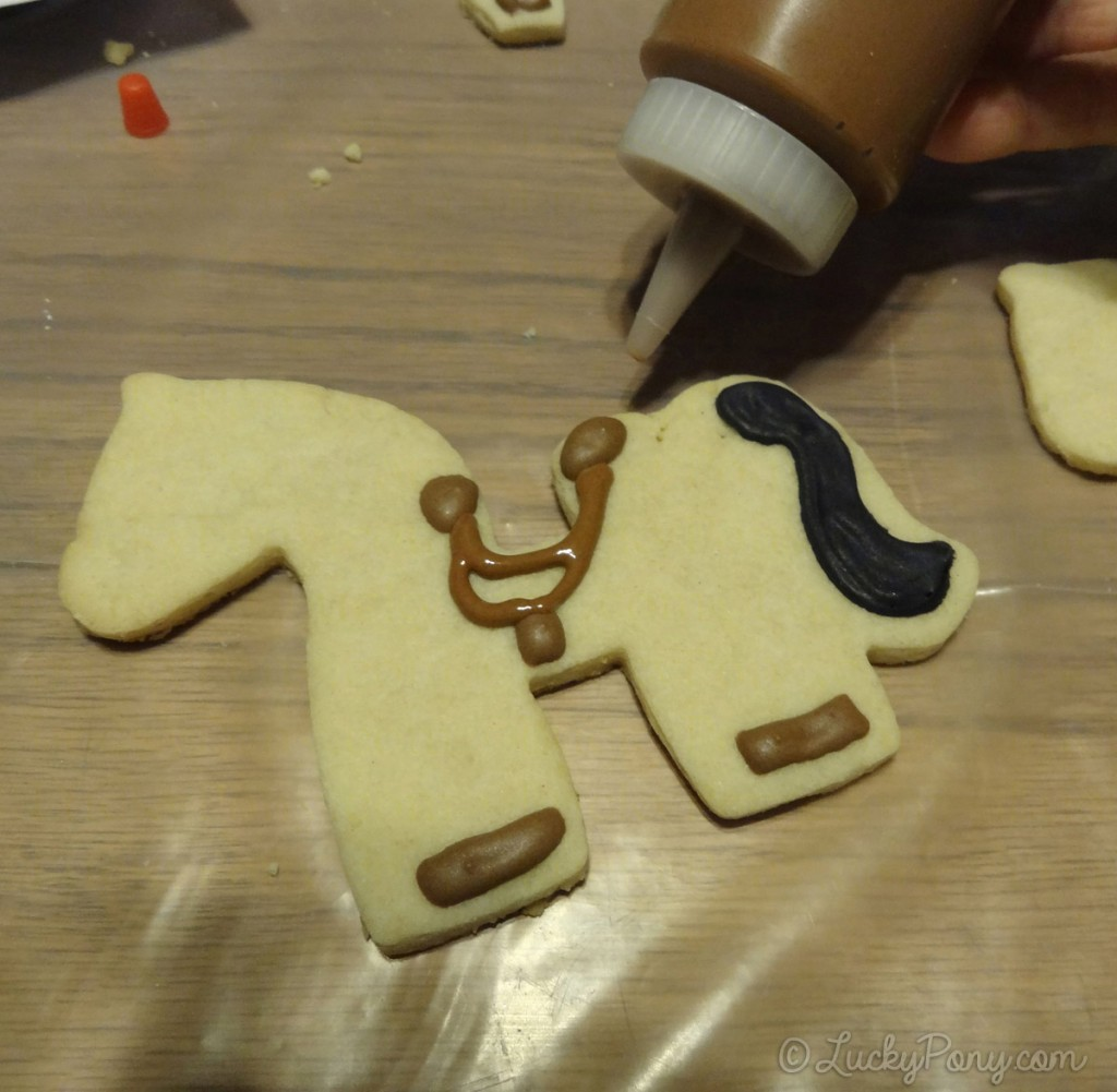 decorating a horse cookie