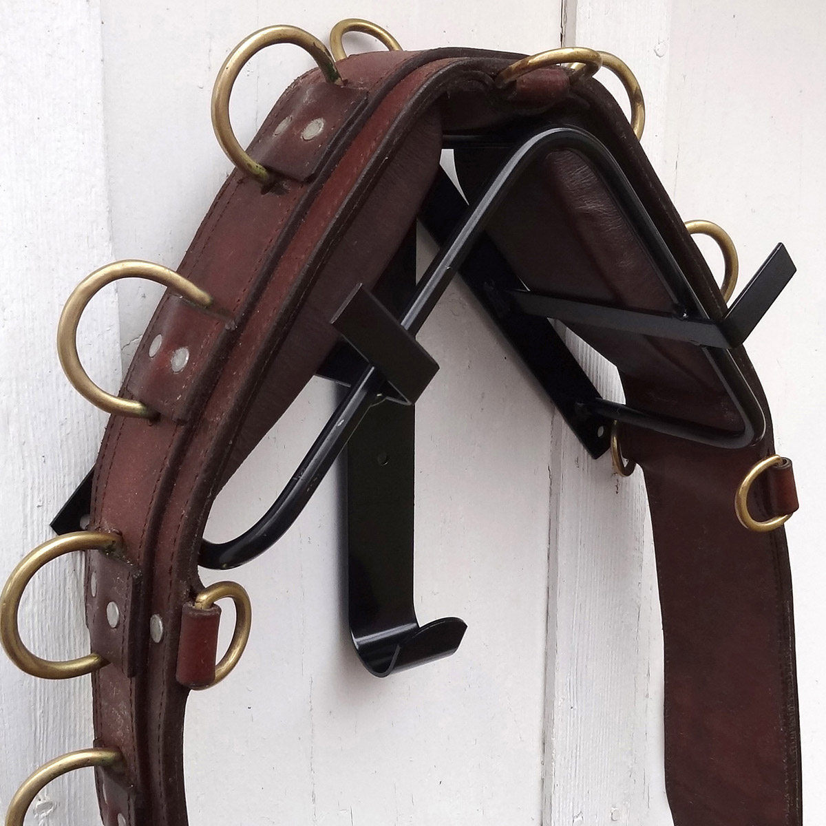 Black Storage Rack For Surcingles And Harness Saddles